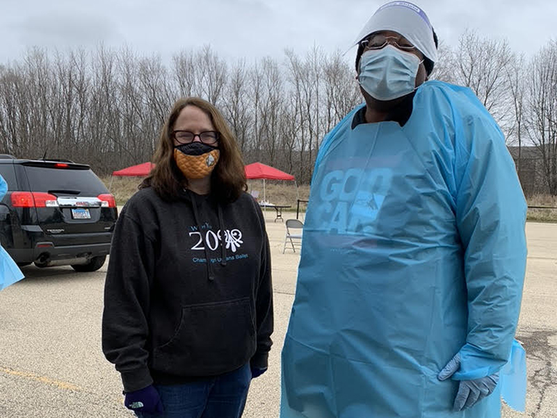 Deb Feinen, mayor of Champaign, Illinois, and Pastor Keith Thomas stand outside during a COVID-19 testing event hosted at Mount Olive Missionary Baptist Church.