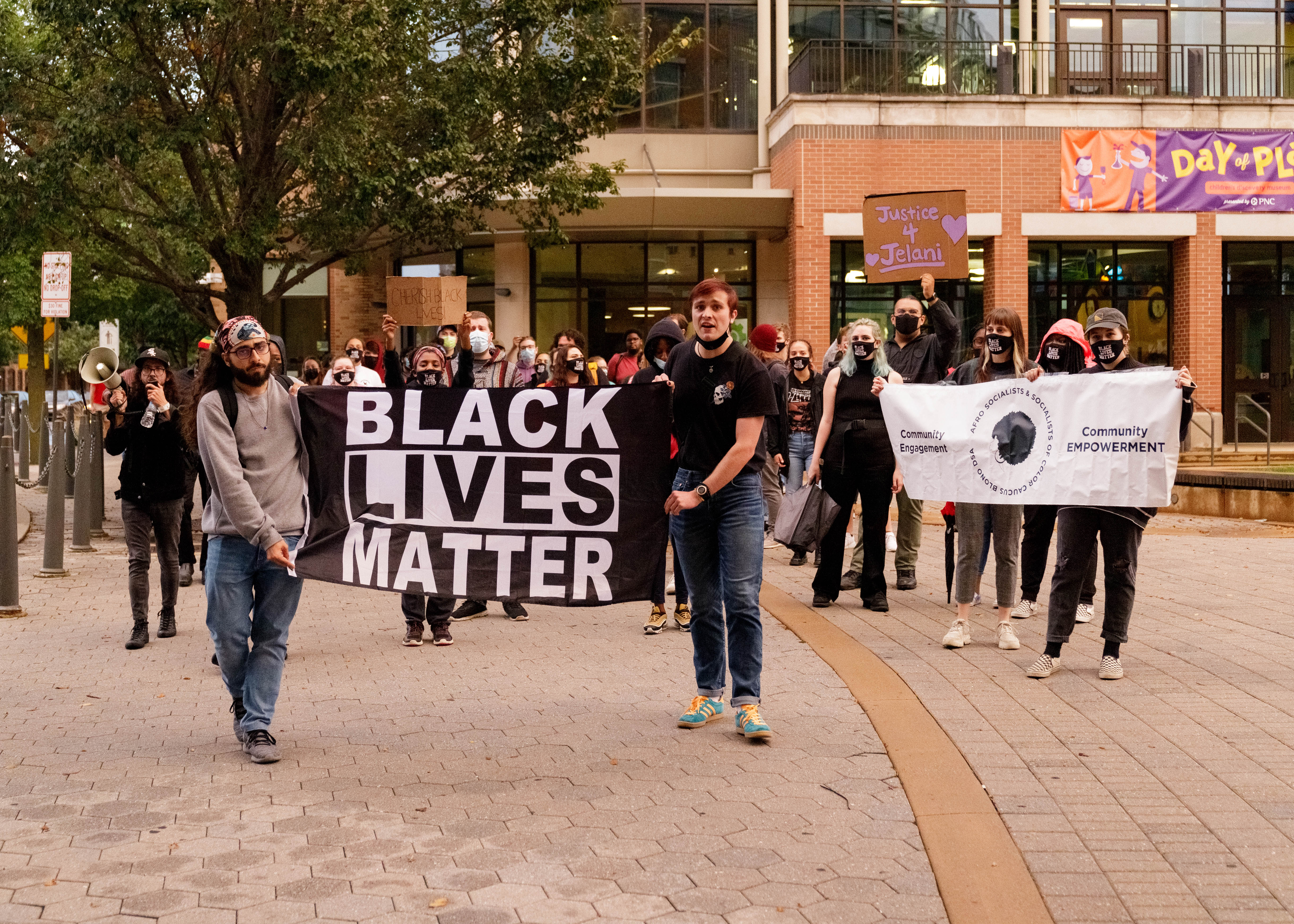 People at a demonstration over the Jelani Day artwork