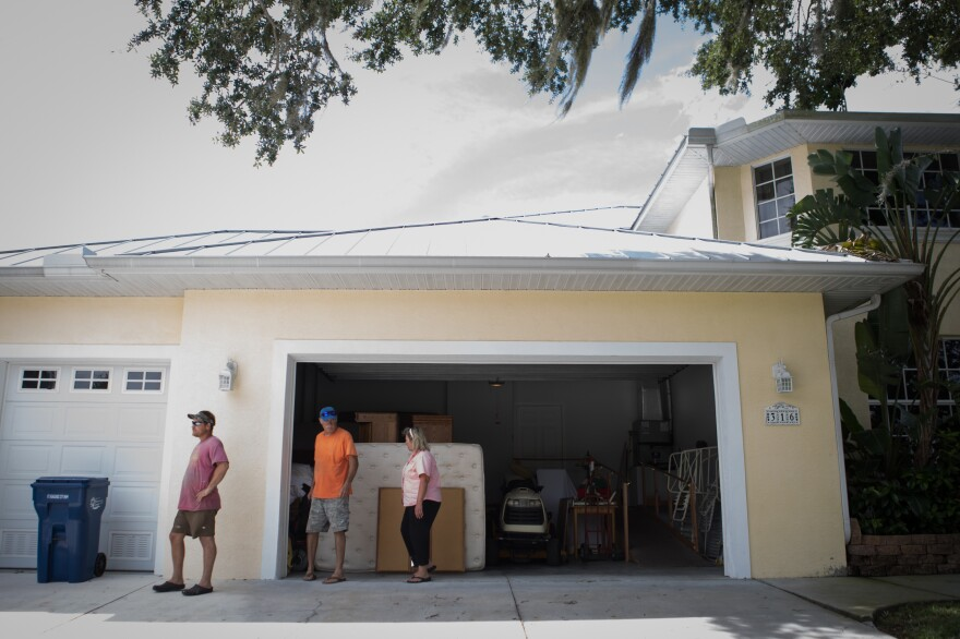 Tim Huffstutler (center), his son Paul and his wife, Janet, plan to stay in their home during Hurricane Irma, despite being under a mandatory evacuation order in Bradenton, Fla.