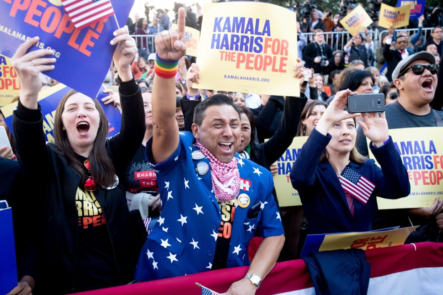 Robert Camacho, center, cheers as California Sen. Kamala Harris launches her presidential campaign in Oakland, Calif., in January.