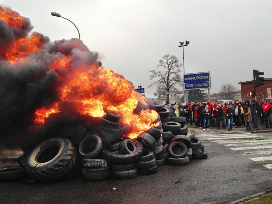 French workers burn tires outside the Goodyear tire factory in Amiens, France, on Tuesday, after Titan CEO Maurice Taylor criticized French workers in a letter addressed to Industrial Renewal Minister Arnaud Montebourg.