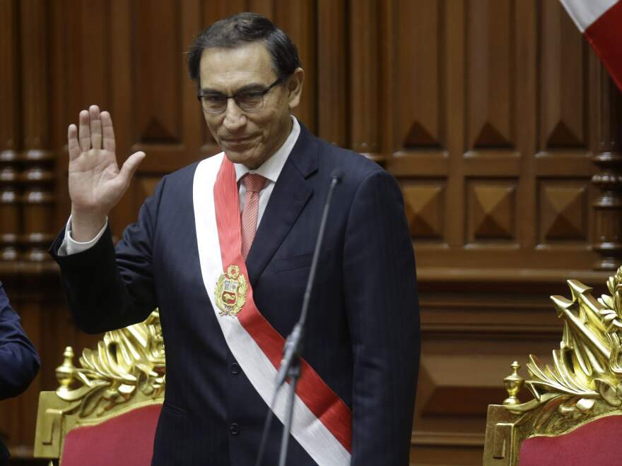 Peru's President Martin Vizcarra waves after he was sworn in Friday, taking over from Pedro Pablo Kuczynski, who resigned over corruption allegations.