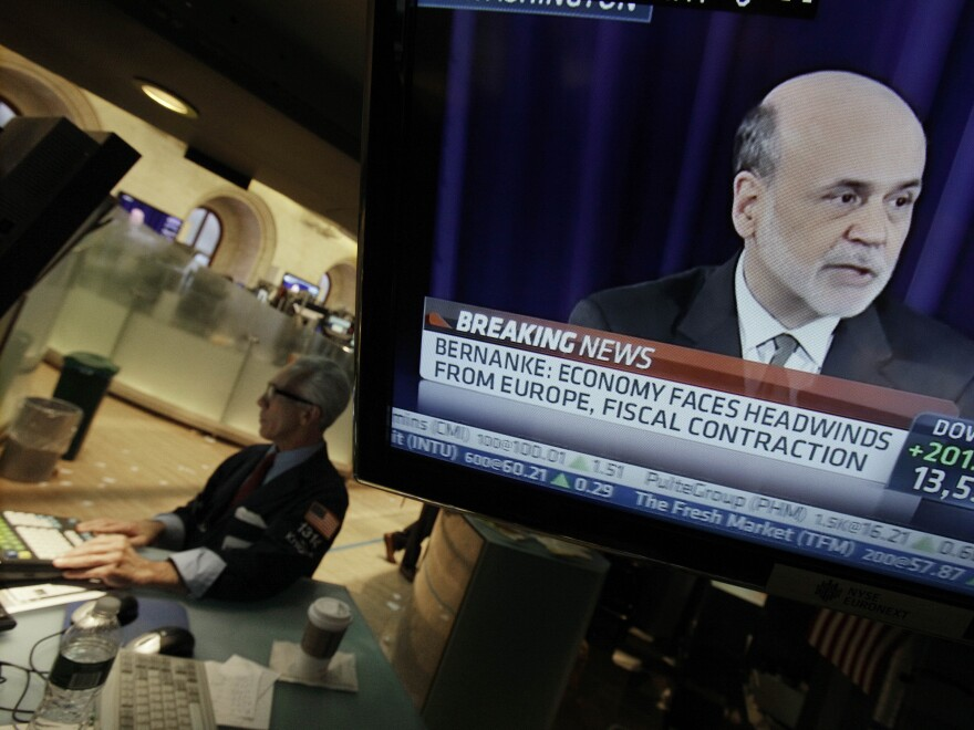 Specialist David Pologruto works at his post on the floor of the New York Stock Exchange on Sept. 13, as Federal Reserve Chairman Ben Bernanke holds a news conference in Washington. The world's central banks are easing credit, putting more money into the global economy.