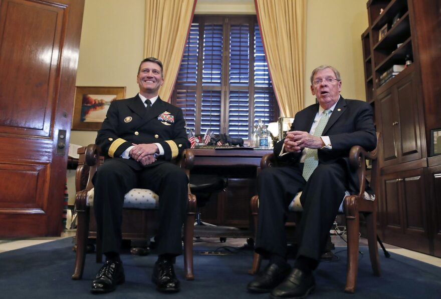 U.S. Navy Rear Adm. Ronny Jackson, M.D., left, sits with Sen. Johnny Isakson, R-Ga., chairman of the Veteran's Affairs Committee, before their meeting on Capitol Hill, Monday, April 16, 2018 in Washington. Jackson is President Donald Trump's nominee to be the next Secretary of Veterans Affairs. (Alex Brandon/AP)
