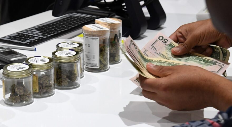 A customer pays for cannabis products at Essence Vegas Cannabis Dispensary in Las Vegas, Nevada.