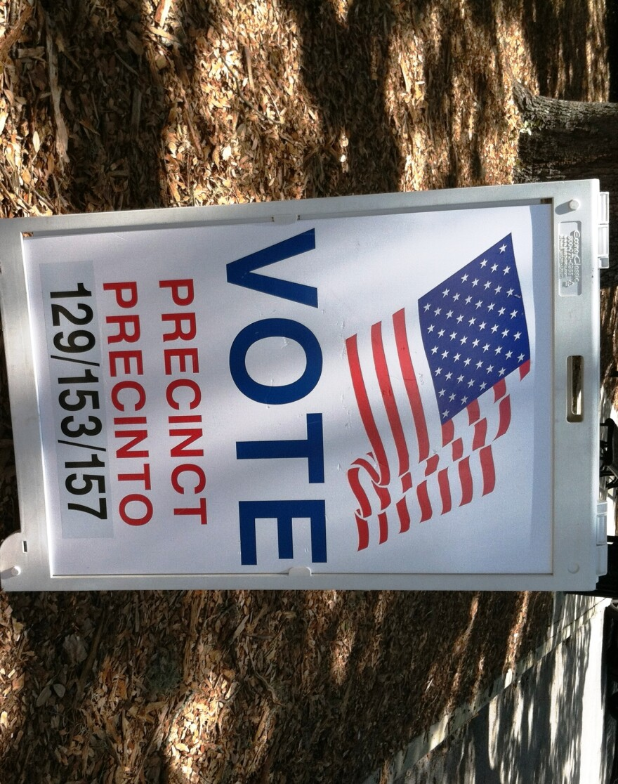 "Sign reading ""Vote precinct precinto"""