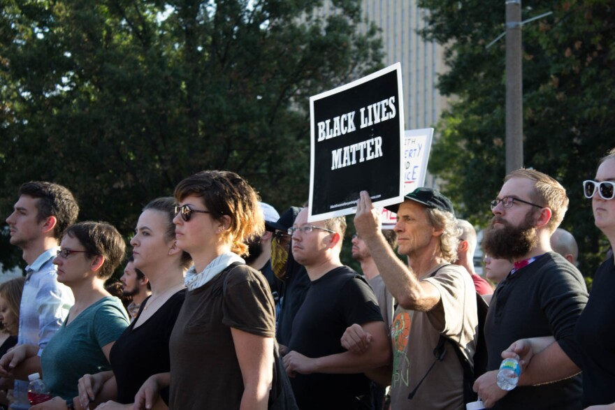 White allies of African-Americans upset by a judge's decision to acquit Jason Stockley of murder protested in downtown St. Louis
