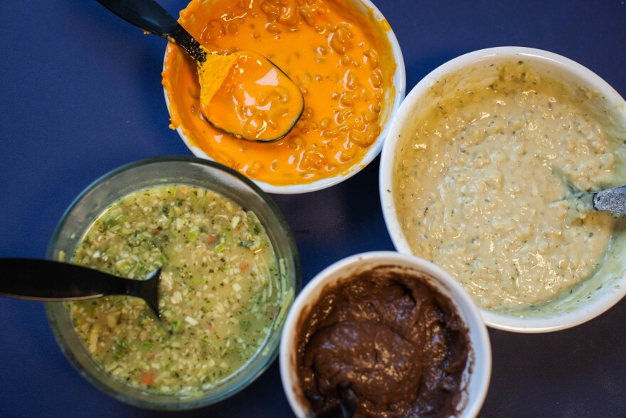 Dishes from Jim Bakker's 50-Day Survival Food bucket, clockwise from top: macaroni and cheese, creamy potato soup, chocolate pudding, chicken noodle soup.