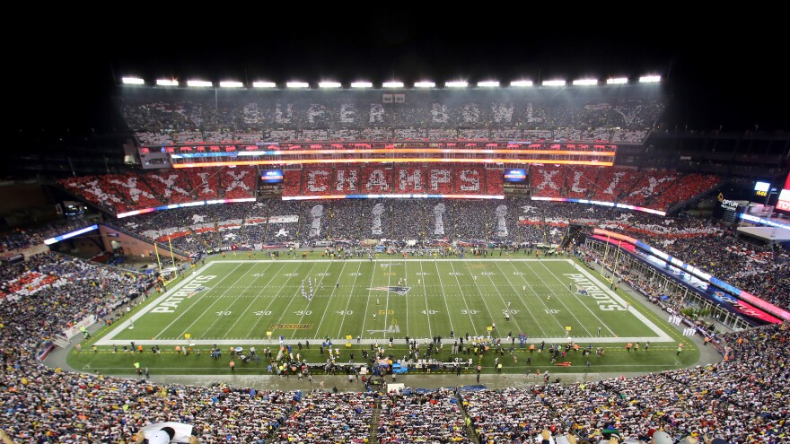 The New England Patriots fans perform a card stunt commemorating their Super Bowl win before their season opener against the Pittsburgh Steelers last week.