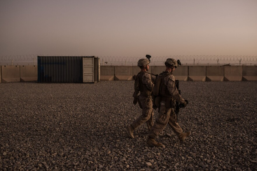 U.S. Marines walk to guard stations at Camp Shorab on Sept. 11, 2017 in Helmand Province, Afghanistan. (Andrew Renneisen/Getty Images)