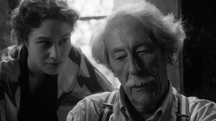 Aging sculptor Marc Cros (Jean Rochefort) finds new inspiration in the person — if not the personality — of a young Spanish refugee (Aida Folch) in <em>The Artist and the Model.</em>