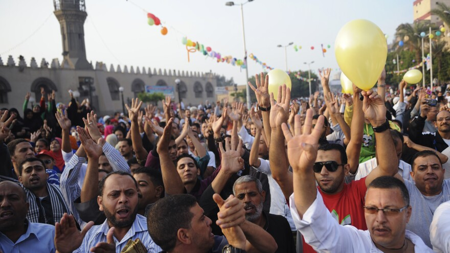 Members of the Muslim Brotherhood and supporters of ousted Egyptian President Mohammed Morsi shout slogans against the military and interior ministry in front of Amr Ibn El-Aas mosque after Eid al-Adha prayers in Cairo on Tuesday. A crackdown on the Muslim Brotherhood has expanded now to charities and mosques linked to the Islamist group.