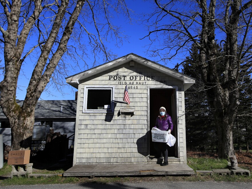 Donna DeWitt at work at the U.S. post office for Isle au Haut, Maine, where she serves about 70 customers. Advocates worry about losing the service in becoming a business.