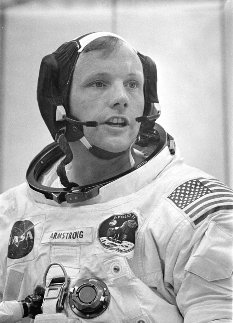 Dunned in his space suit, mission commander Neil A. Armstrong does a final check of his communications system before before the boarding of the Apollo 11 mission.