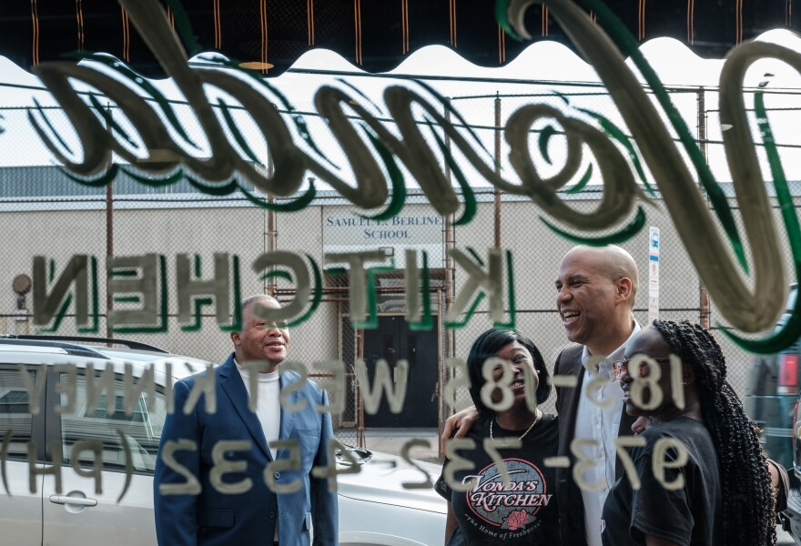 Senator and 2020 presidential hopeful Cory Booker greets supporters outside Vonda's Kitchen in Newark, N.J.
