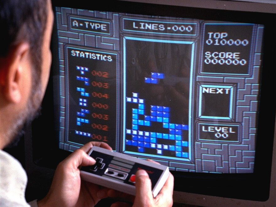 "Tetris, an addictive brain-teasing video game, is shown as played on the Nintendo Entertainment System in New York, June 1990. Its creator, a Soviet computer programmer, explained the game appeals to people's ""constructive spirit."""