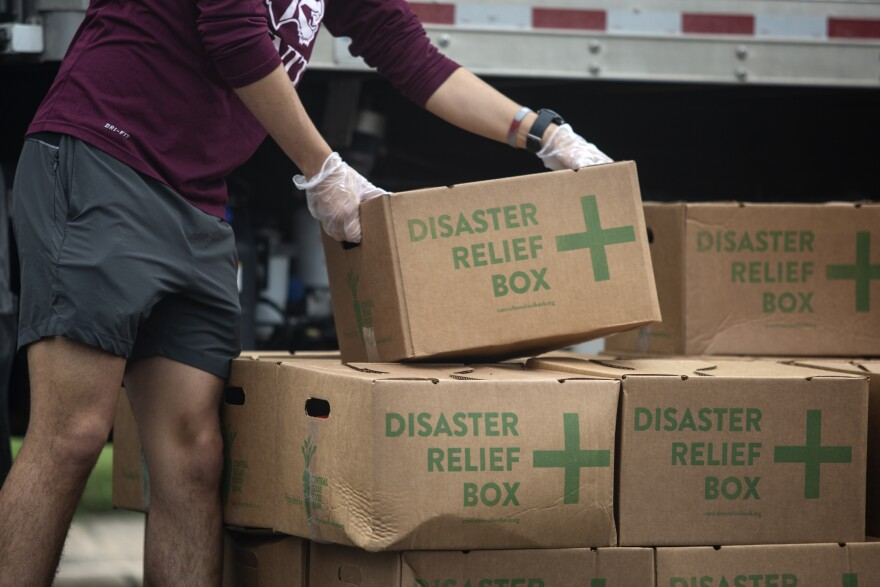 Central Texas Food Bank volunteers distribute boxes of food during the coronavirus pandemic.