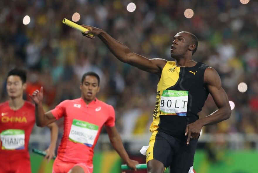 Jamaica's Usain Bolt celebrates after winning the men's 4x100-meter relay in Rio on Friday night. Bolt won his third gold in Rio, and his ninth overall, tying the all-time record for track and field athletes.