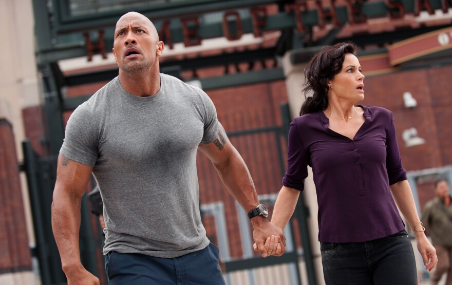 "Dwayne ""The Rock"" Johnson and Carla Gugino star in the action thriller <em>San Andreas</em>."