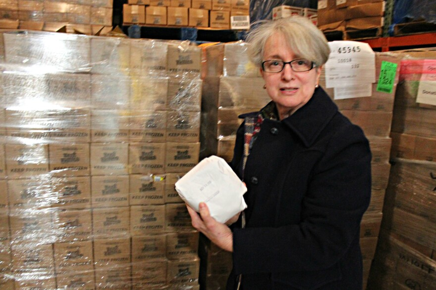 Operation Food Search executive director Sunny Schaefer shows off ground venison stored in a freezer that was donated through the Share the Harvest program.