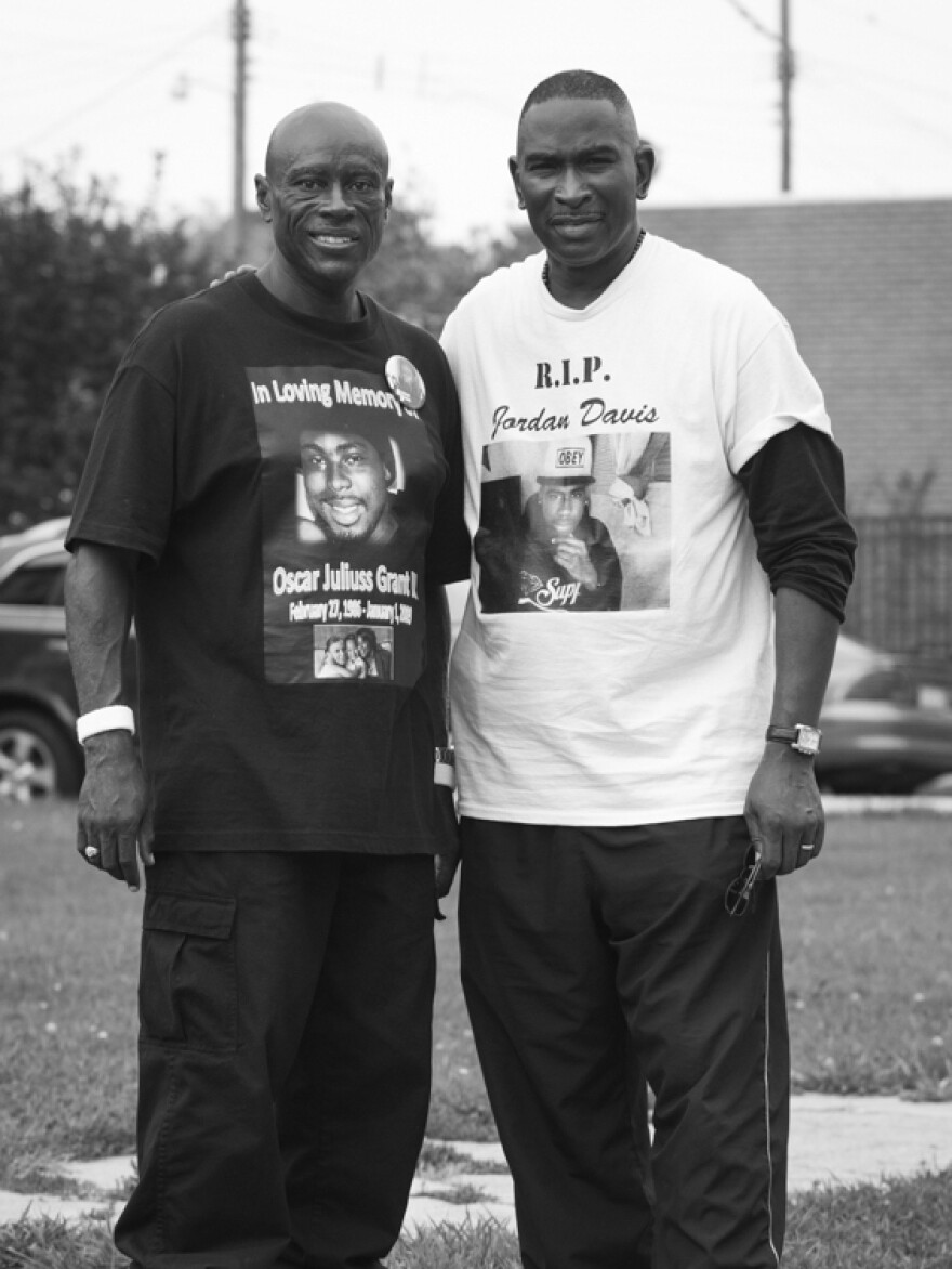 Cephus Johnson (left) is the uncle of Oscar Grant, who was killed in Oakland, Calif., in 2009. He stands in Ferguson with Ron Davis, whose son Jordan was 17 when he was shot and killed in Florida in 2012.