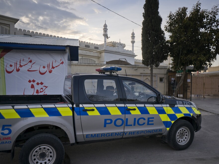 A police vehicle is parked outside a mosque belonging to a banned religious group in Islamabad, Pakistan. Prime Minister Imran Khan has ordered the takeover of assets and property of dozens of militant organizations who continue operating in Pakistan.