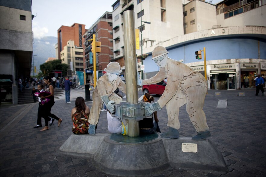 A sculpture of oil workers in Caracas, Venezuela. The country is heavily dependent on oil exports, and falling oil prices have had a ripple effect on the country's already troubled economy.
