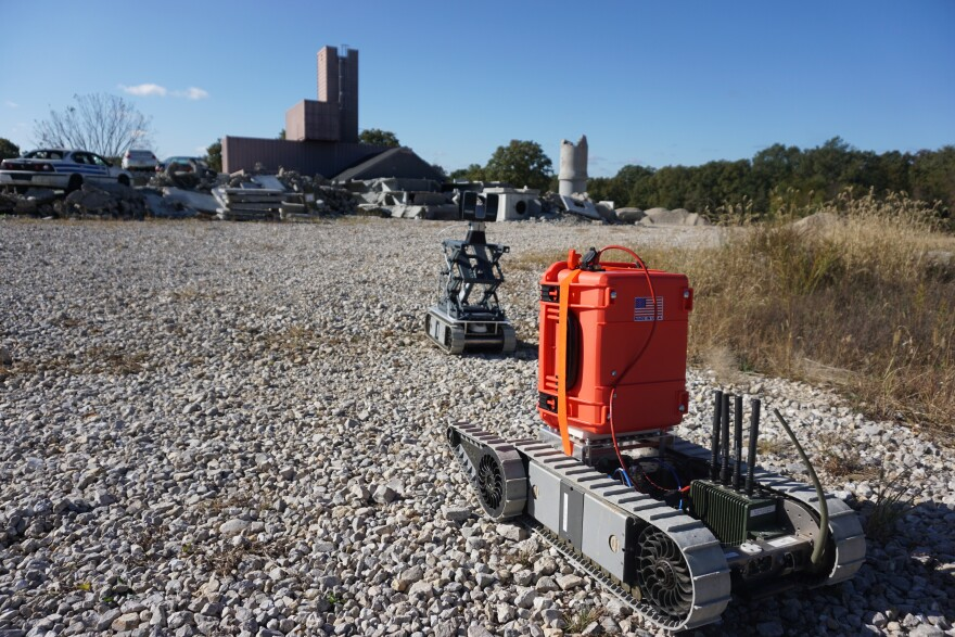 Robots mounted with new detection equipment roll toward a simulated collapsed building at Fort Leonard Wood as part of testing of new technology. 10-18-19