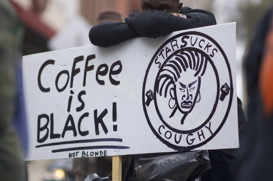 Protester Jack Willis, 26, demonstrates outside a Starbucks in Philadelphia. Police arrested two black men who were waiting inside a Center City Starbucks which prompted an apology from the company's CEO.