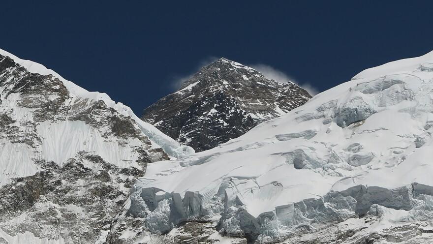 Mount Everest towers over the landscape miles northeast of Nepal's capital, Kathmandu, last month.