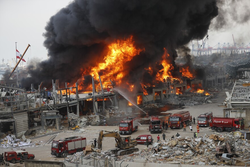 A huge fire burns Thursday at Beirut's port, triggering panic among residents traumatized by last month's massive explosion that killed nearly 200 people and injured thousands.