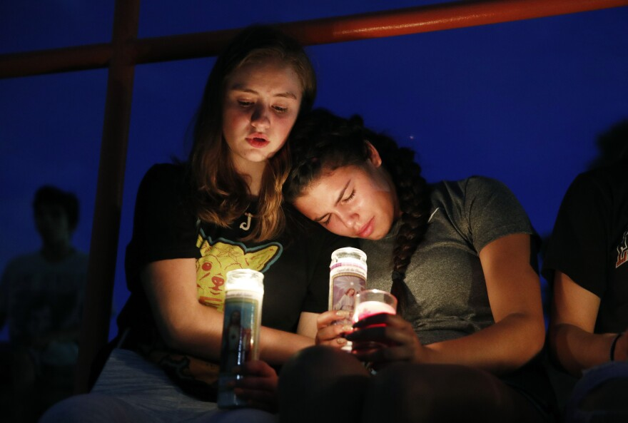 Melody Stout and Hannah Payan comfort each other during a vigil Saturday night for victims of the El Paso shooting.