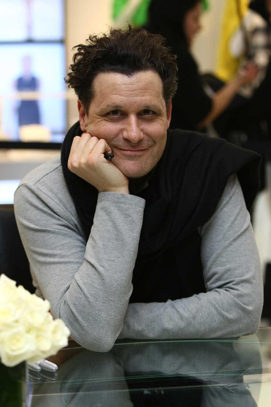 Mizrahi has become a familiar face in fashion, appearing on QVC and <em>Project Runway All Stars.</em> He's pictured above at the Liz Claiborne New York Spring fashion show in March 2009.