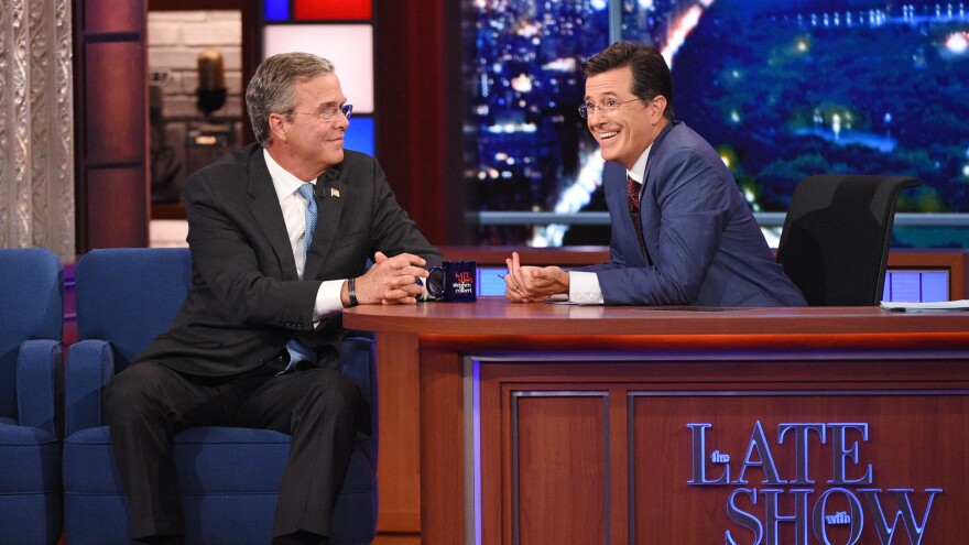 Stephen Colbert talks with Jeb Bush during Colbert's debut as <em>Late Show</em> host. The Republican presidential candidate and actor George Clooney were guests on the show.