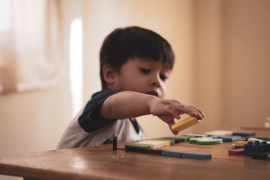 boy-holding-block-toy.jpg