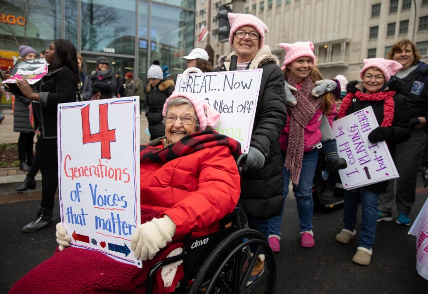 Virginia Gordon, 96 (seated in wheelchair) from Champagne, Ill., leads a family cohort of four generations of women attending the Women's March.
