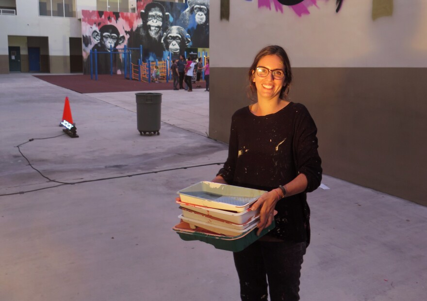 Marina Capdevila is one of dozens of artists who painted murals at Eneida Hartner Elementary School in Miami as part of a project called Reimagining the Arts in Wynwood.