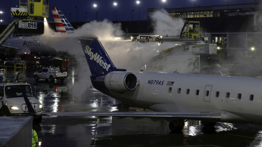 A deicing agent is applied to a SkyWest airplane before its takeoff on Jan. 18, 2019, at O'Hare International Airport in Chicago.