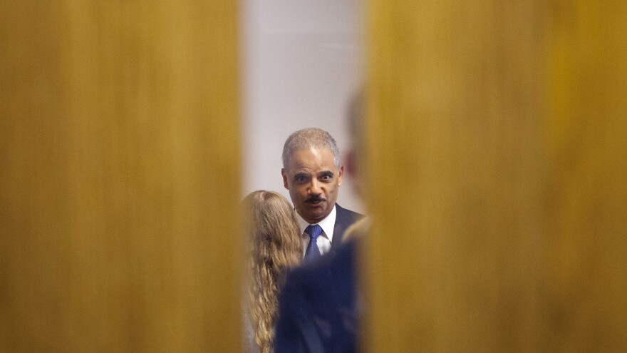 Attorney General Eric Holder visited Ferguson, Mo., in August, where he met with elected and police officials and community members.