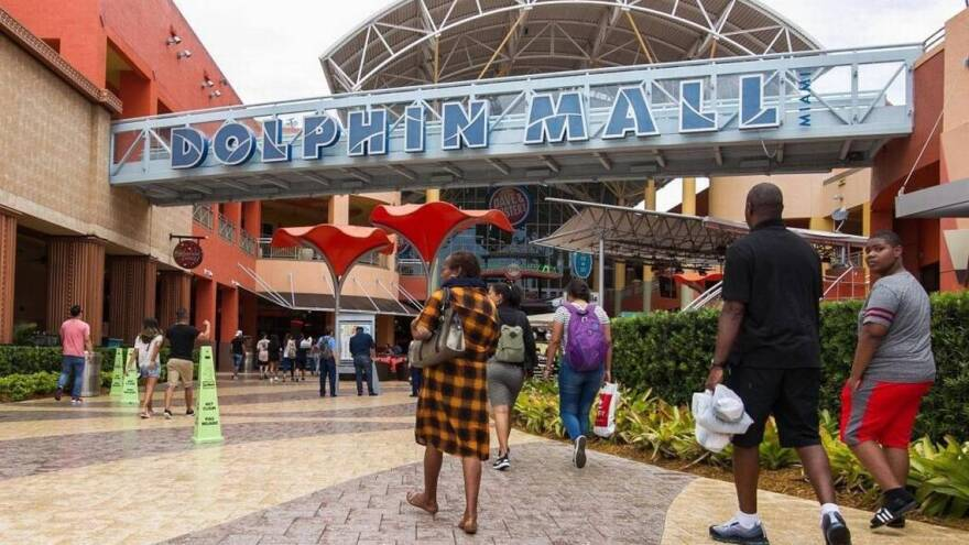 Shoppers enter Dolphin Mall on Aug. 20, 2017.