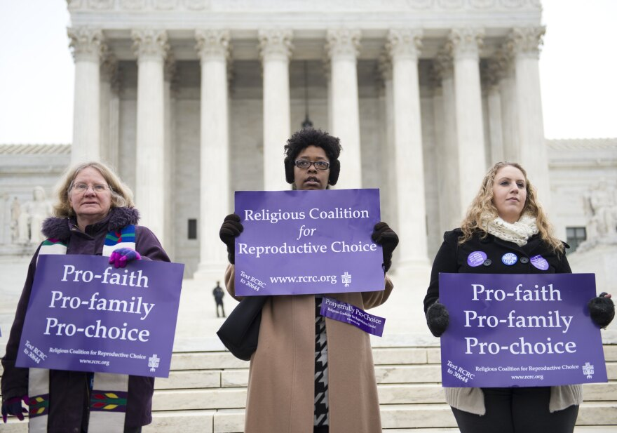 Pro-choice demonstrators stand outside the Supreme Court following oral arguments on the buffer-zone case.