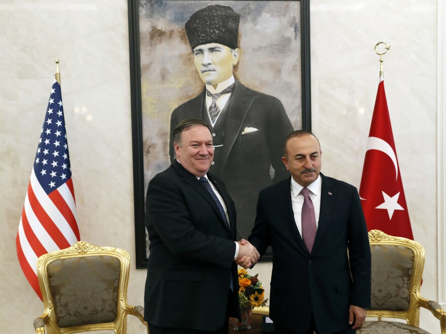 U.S. Secretary of State Mike Pompeo shakes hands with Turkish Foreign Minister Mevlut Cavusoglu before their official talks in Ankara, Turkey, on Wednesday.