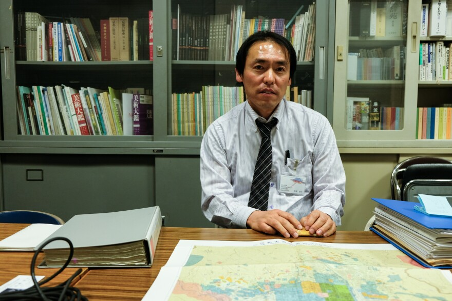 Archaeologist Tomomitu Umase, who runs the Kyoto city government office in charge of archaeology, displays a map of historical sites around the former imperial capital. He estimates that only 1 percent of the relics uncovered by a pre-Olympic building boom are being preserved.