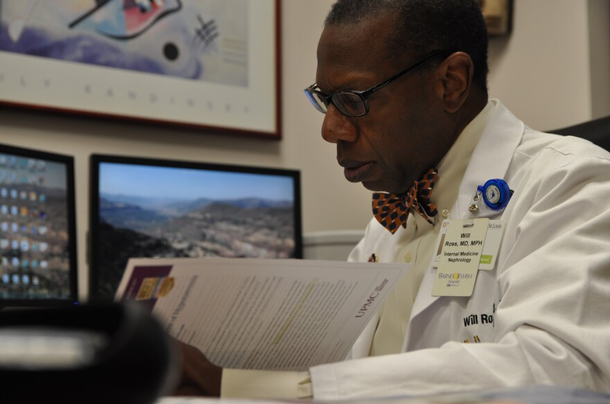 Dr. Will Ross, a kidney specialist and associate dean at Washington University, reads a clinical paper in his office. Ross is co-authoring a book on the legacy of Homer G. Phillips Hospital.