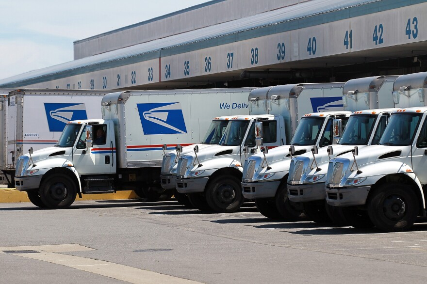 A U.S. Postal Service truck backs into a dock at the U.S. Post Office sort center on August 12, 2011 in San Francisco, California. The USPS has partnered with TuSimple to launch a multistate driverless semitruck test program on Tuesday. It doesn't involve home deliveries.