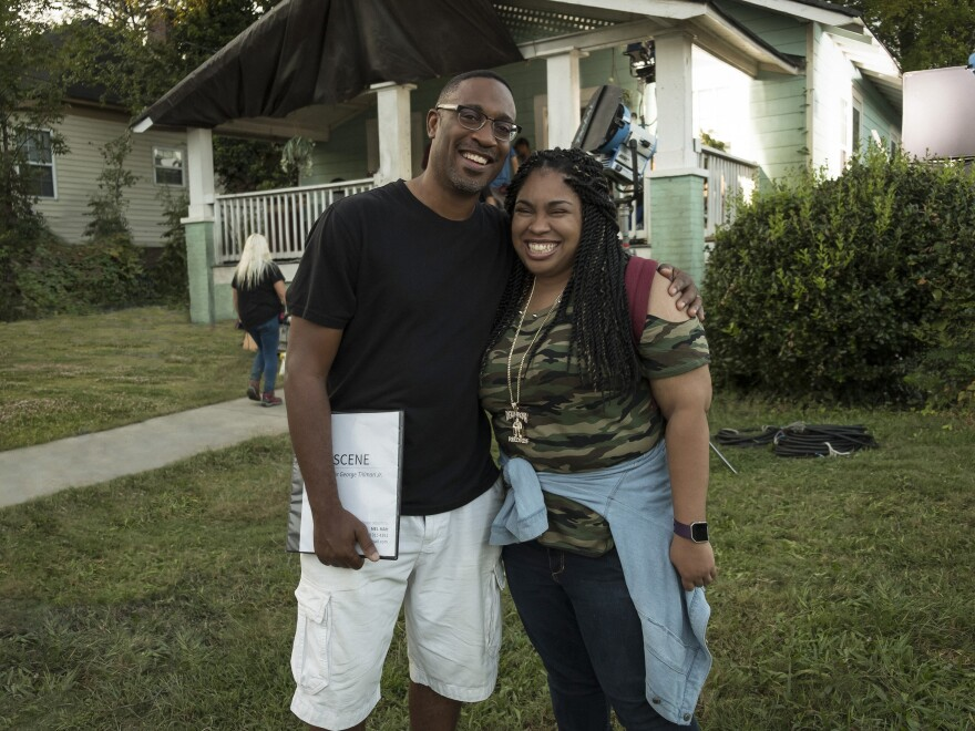 Director George Tillman, Jr. and author Angie Thomas pose on the set of <em>The Hate U Give</em>.