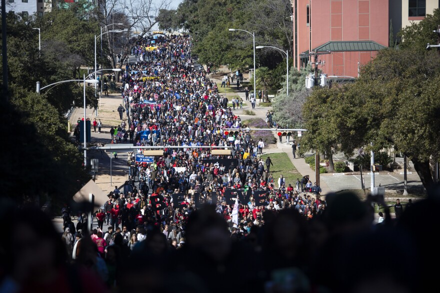A crowd marches through Austin streets on Martin Luther King Jr. Day.