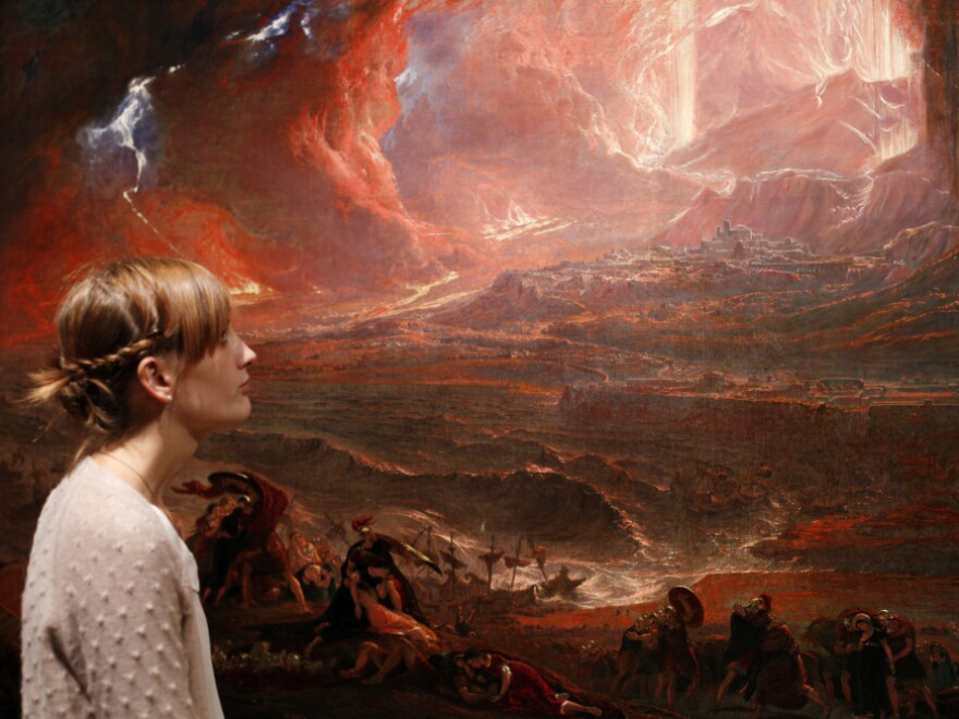 A museum employee looked at John Martin's recently restored <em>The Destruction of Pompeii and Herculaneum</em>, at the Tate Britain in central London on Monday (Sept. 19, 2011).