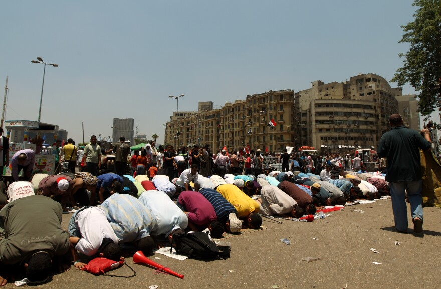 "Egyptian supporters of their new president-elect, Muslim Brotherhood leader Mohamed Morsi, perform noon prayers in Cairo's Tahrir Square, one day after Morsi was elected as the country's ""first civilian president"" on Sunday."