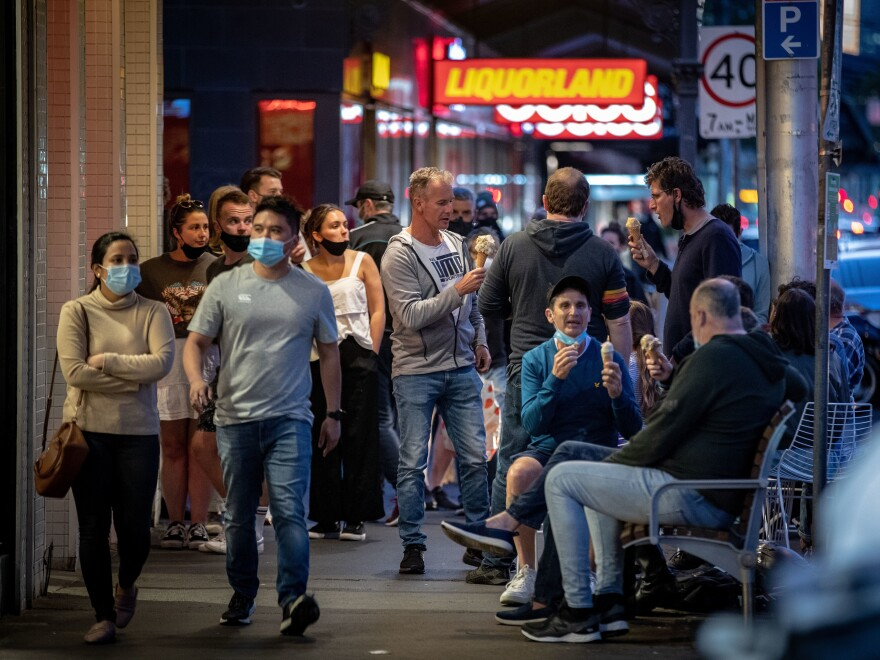 People enjoy eating outdoors on Wednesday in Melbourne, Australia. Lockdown restrictions in the city were lifted after 111 days, allowing people to leave their home for any reason.